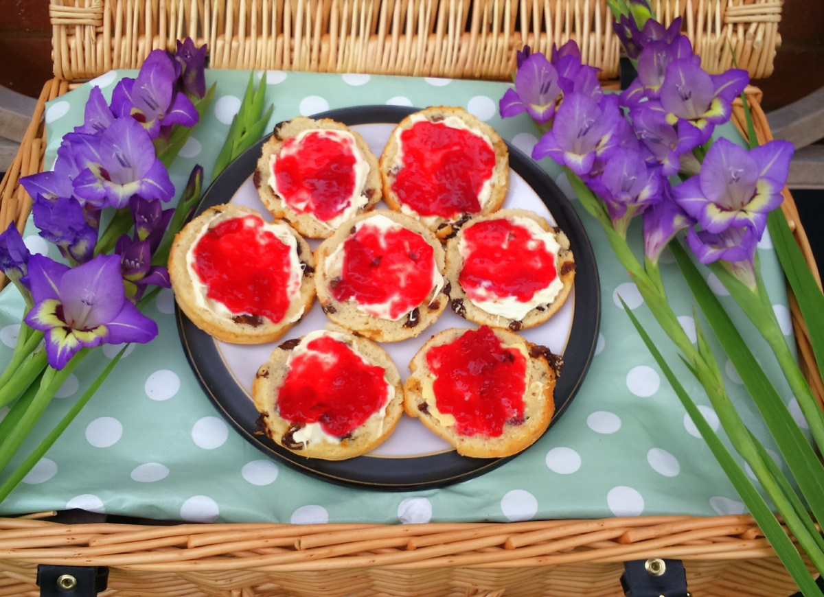 Scones with raspberry jam and clotted cream - perfect for a summer afternoon tea